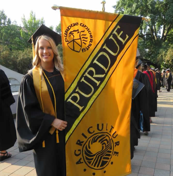 Graduate with banner